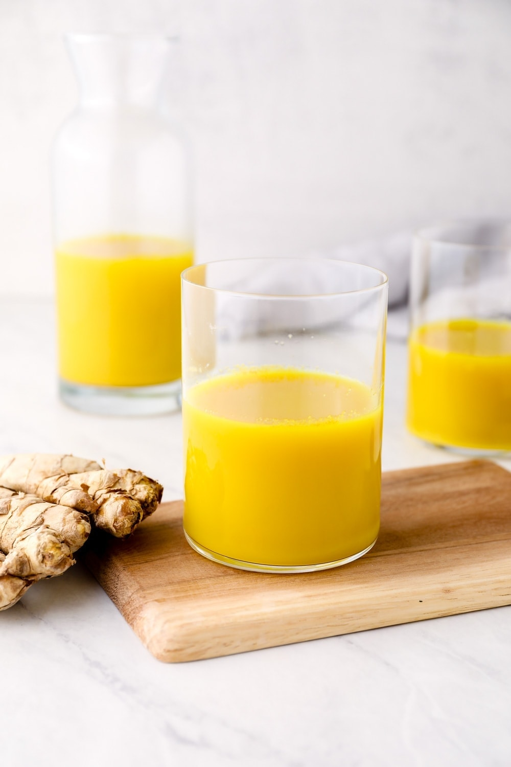 Ginger Juice in glasses with honey.