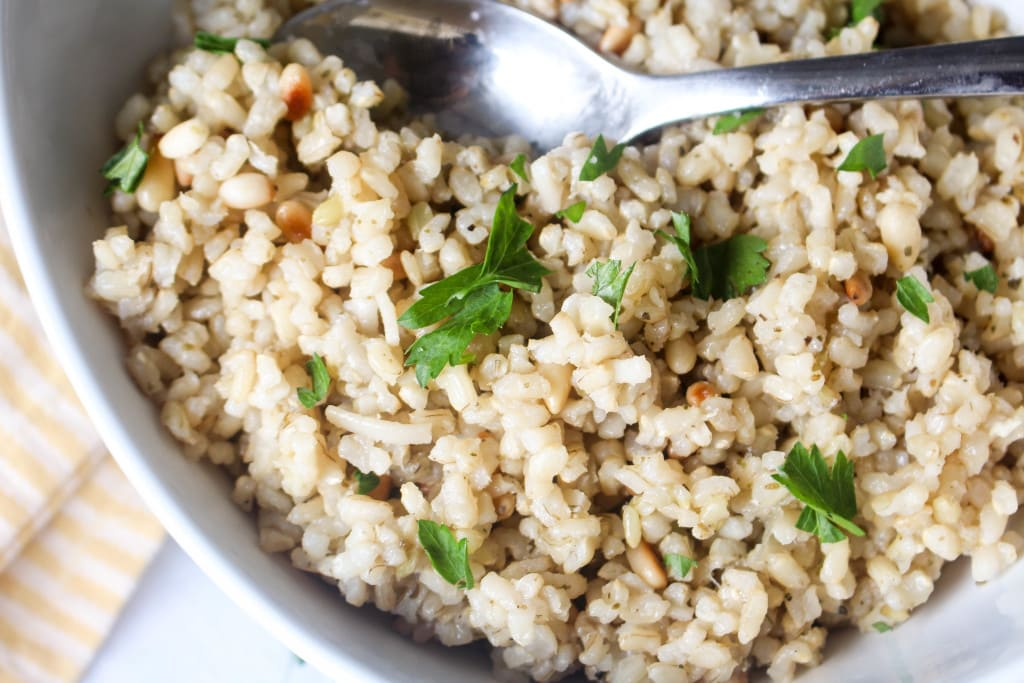 This recipe is full of nutty toasted rice and crunchy pine nuts. It pairs well with SO MANY entres!
