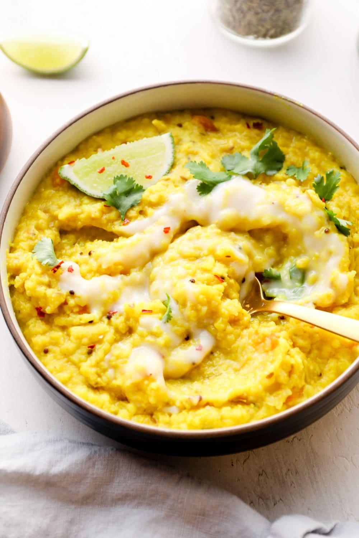 Kitchari with a coconut yogurt swirl and red pepper flakes.