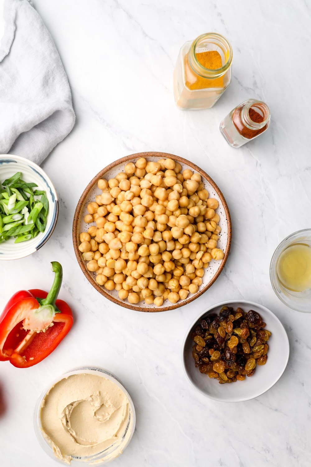 Ingredients needed to make  Curry Chickpea Salad in bowls.