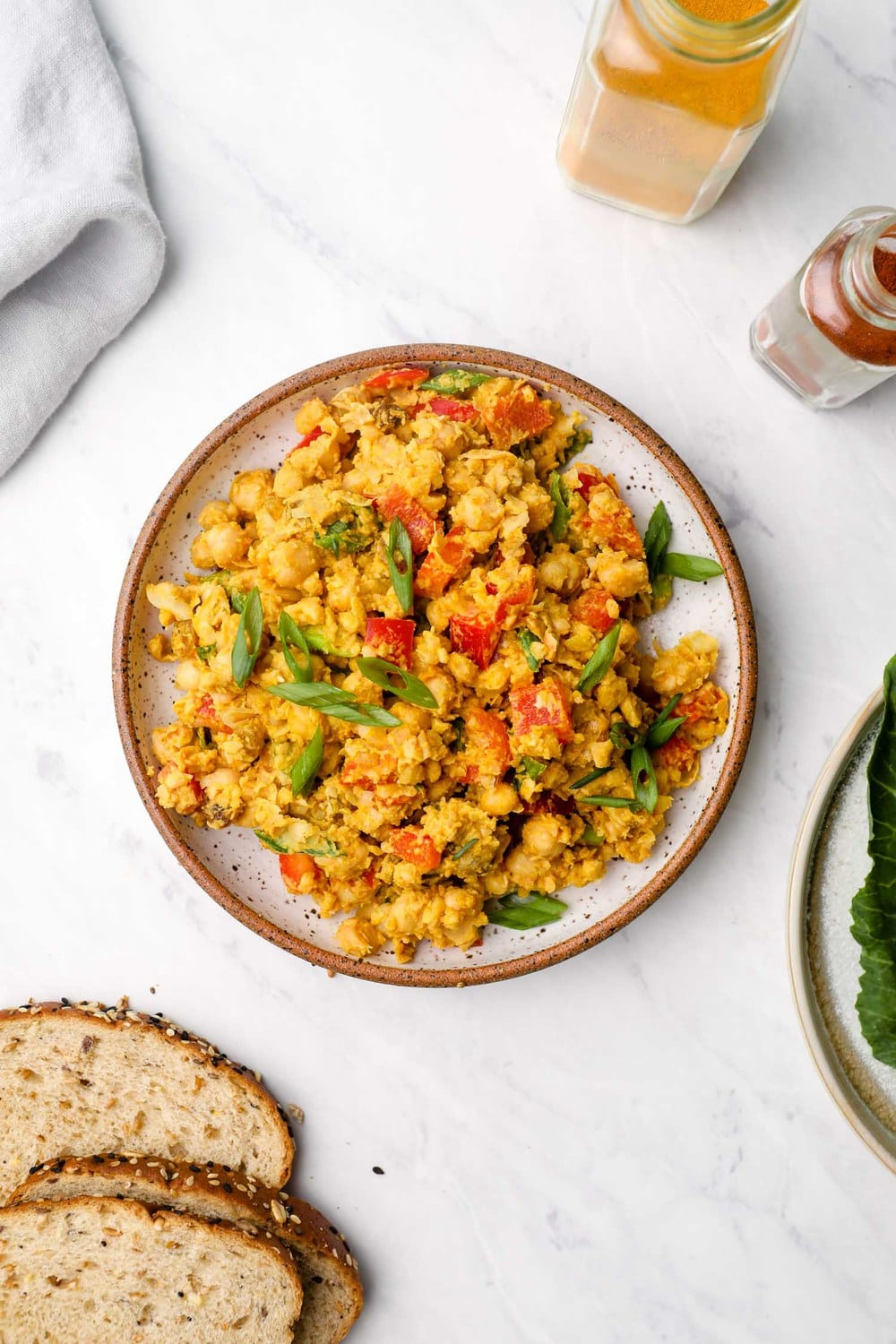 Curry Chickpea Salad on a plate with bell peppers.