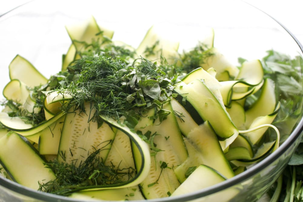 This recipe uses summer garden staples: zucchini and fresh herbs