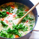 You will never believe this Sweet Potato Kale Chowder Recipe is secretly healthy! It is SO incredibly creamy. Find out the secret trick for thick and creamy dairy-free soup! | CatchingSeeds.com