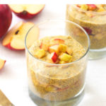 A cup filled with pumpkin spice chia seed pudding with apple compote.