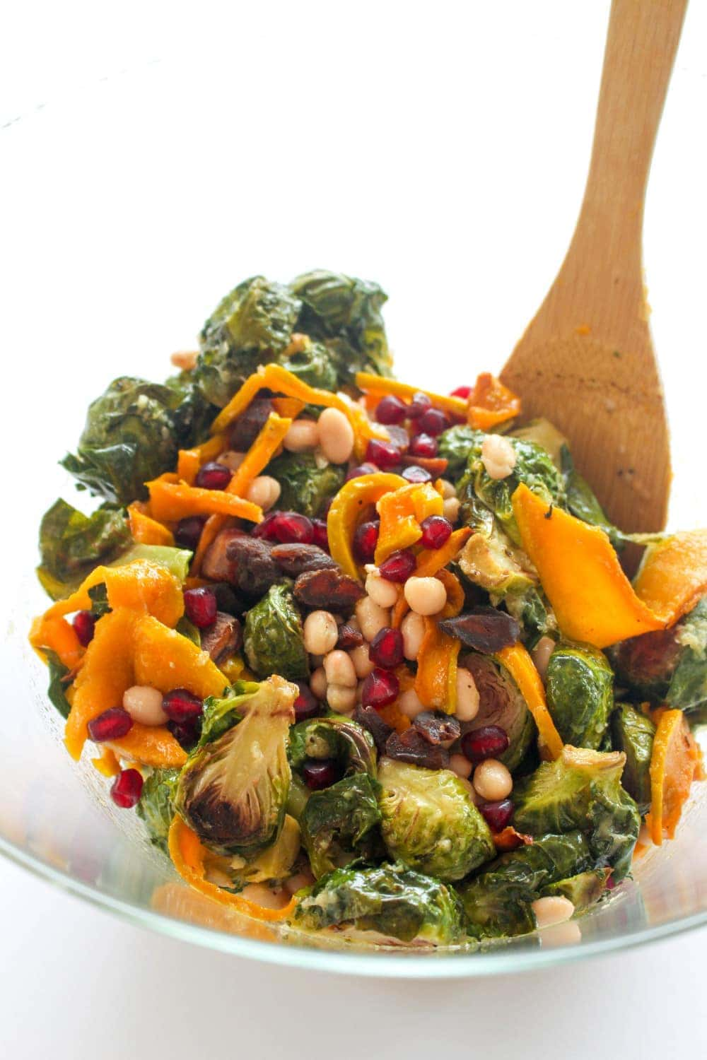 This nutrient dense salad is packed with caramelized squash, brussel sprouts, beans, and dried apricots! #glutenfree #vegan
