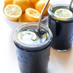 This Charcoal Black Lemonade recipe can help rid your body of toxins and reduce bloating all white tasting just like a tall glass of freshly squeezed lemonade. | CatchingSeeds.com