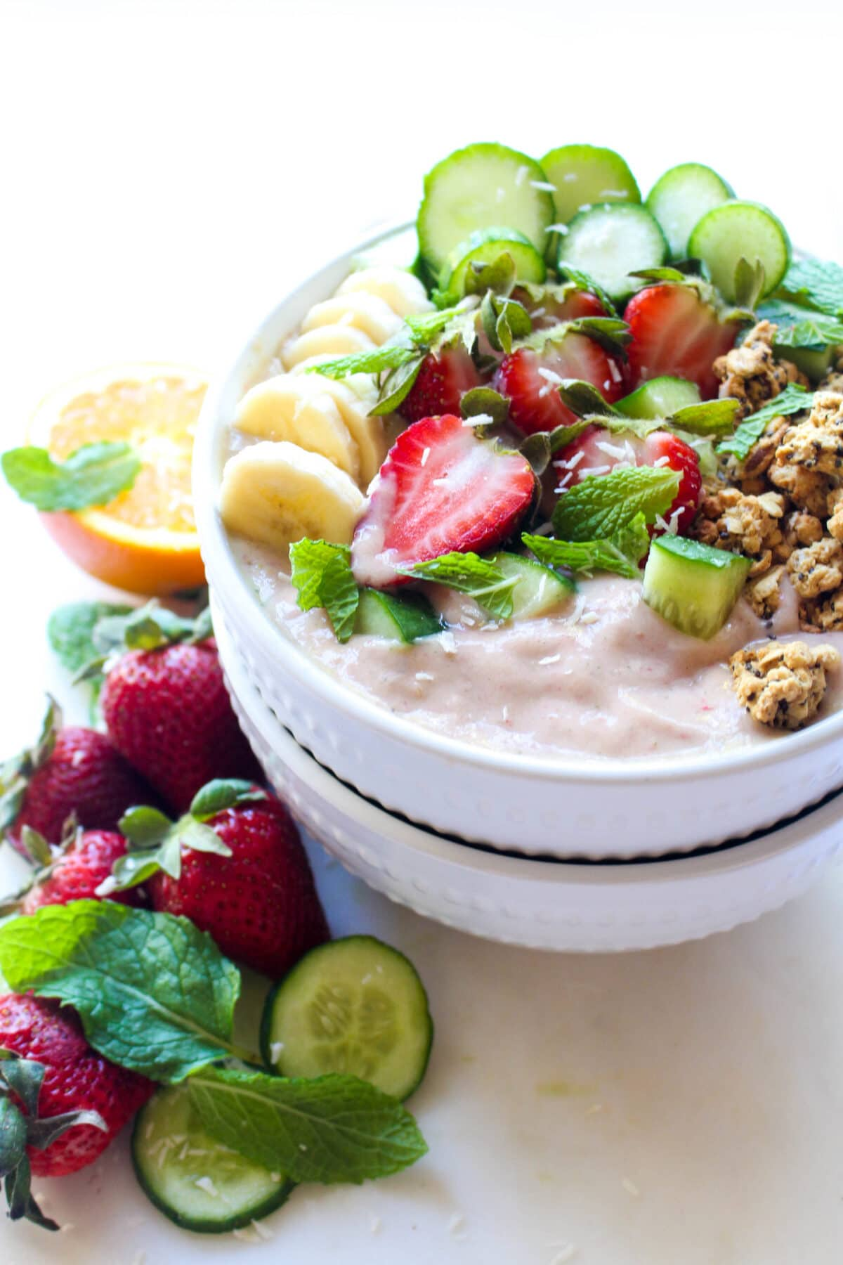 This Strawberry Cucumber Smoothie Bowl recipe tastes like spring! A healthy and quick breakfast idea.