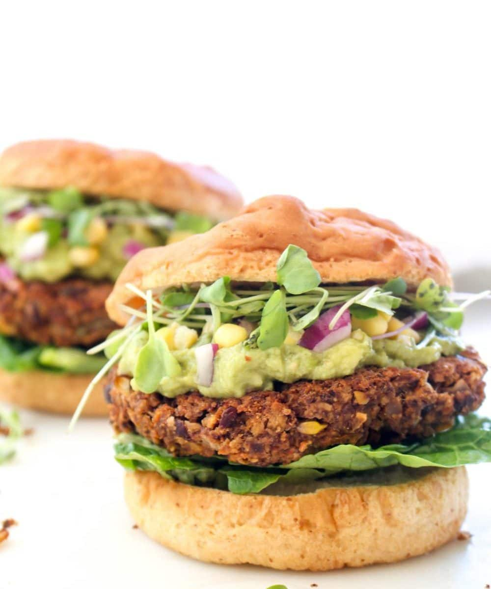 A thick juicy black bean patty topped with guacamole, corn salsa, and sprouts.