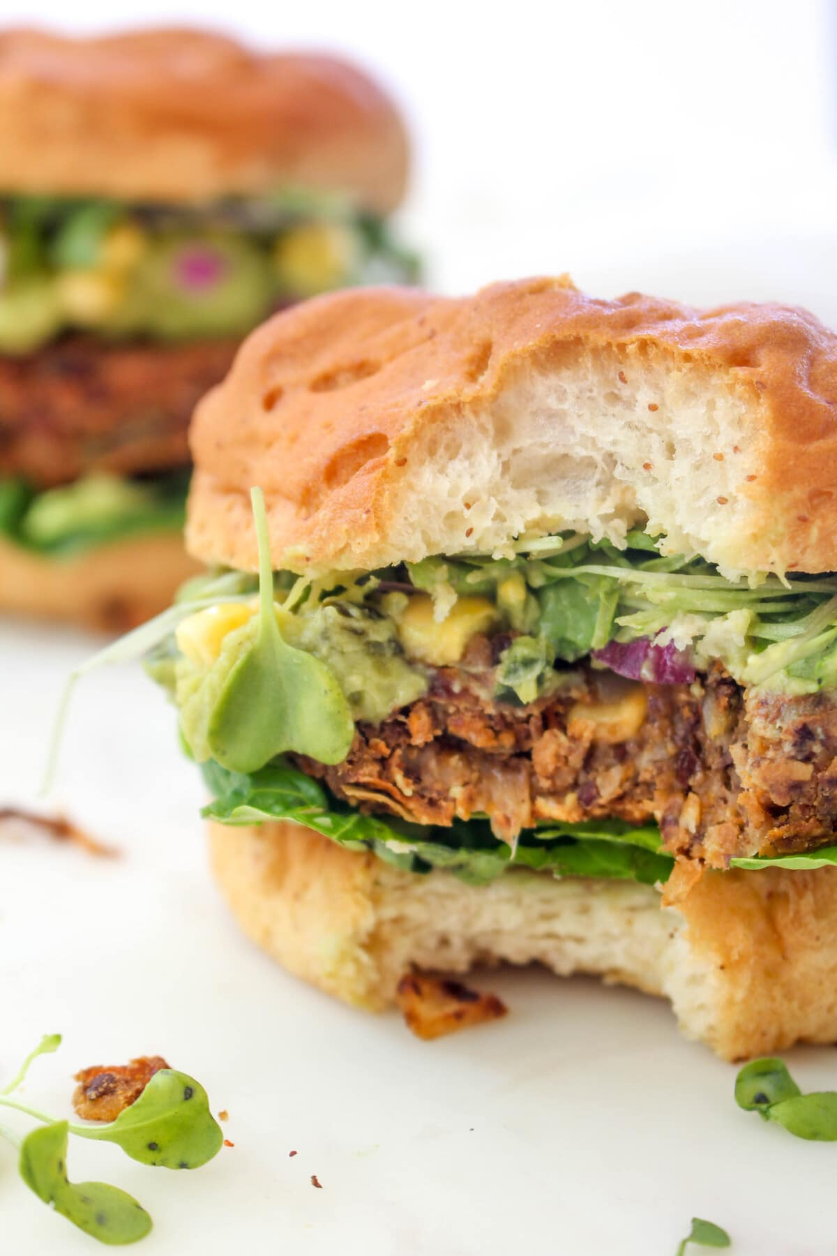This California Burger is a big juicy vegan burger loaded with guacamole, fresh corn salsa and sprouts. It is lean and clean West Coast cuisine meets decadent burger.