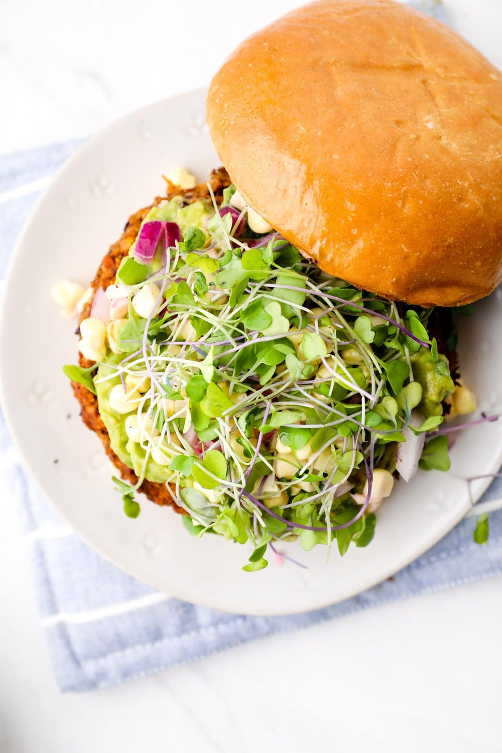 A California Burger veggie patty with sprouts.