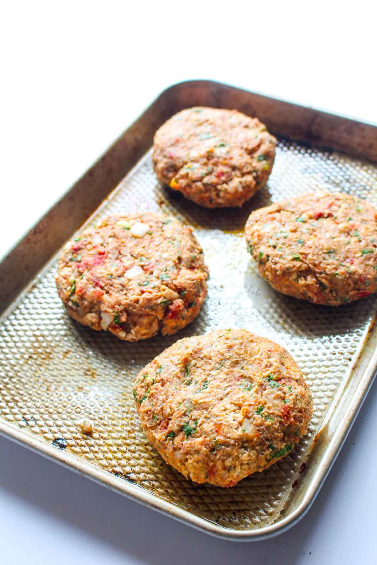 These Mediterranean Chickpea Burgers are jam packed with flavor! This healthy recipe is gluten free, vegan and surprisingly easy to make. | CatchingSeeds.com