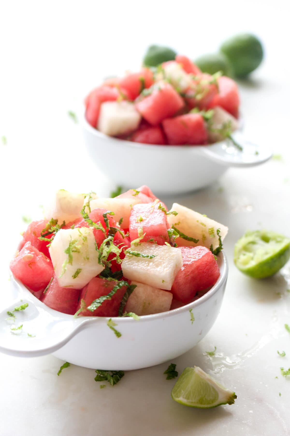 A refreshing watermelon salad recipe with jicama, mint, and lime! Perfect for a barbeque or potluck!