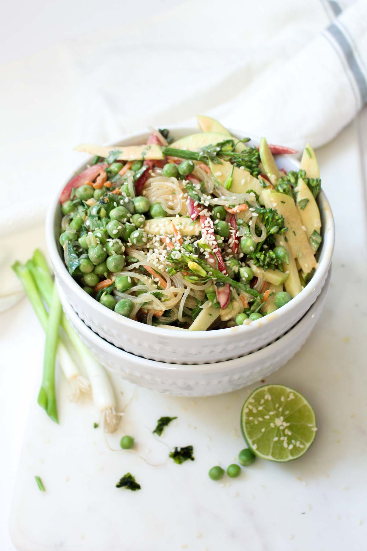 This Rawkin' Raw Noodle Bowl is a quick and easy no cook summer dinner! This healthy recipe is loaded with veggies and coated with a creamy dressing. | CatchingSeeds.com