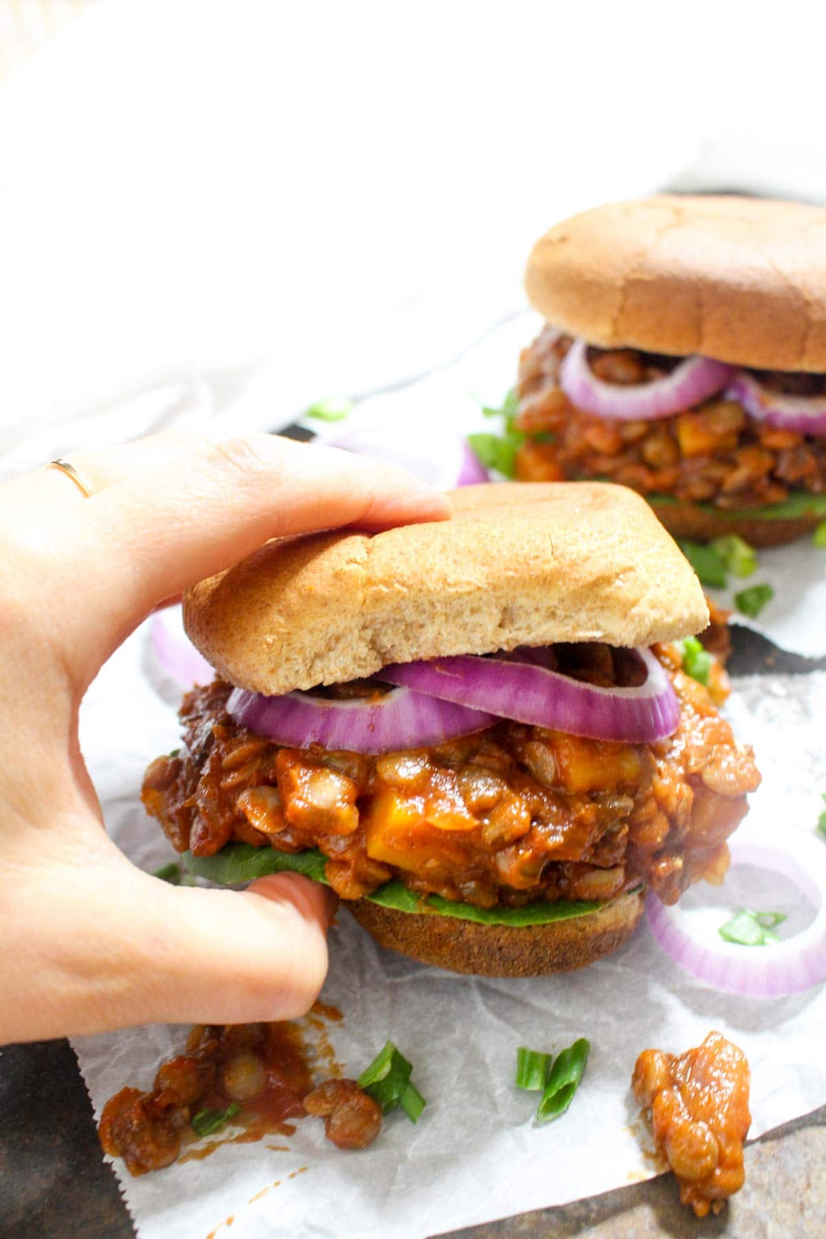 These Pumpkin Sloppy Joes recipe has a killer homemade sauce that is sweet, tangy, and perfectly tomatoe-y. They are an easy, gluten free, and vegan weeknight dinner. The addition of pumpkin makes them perfect for fall! | Catching Seeds