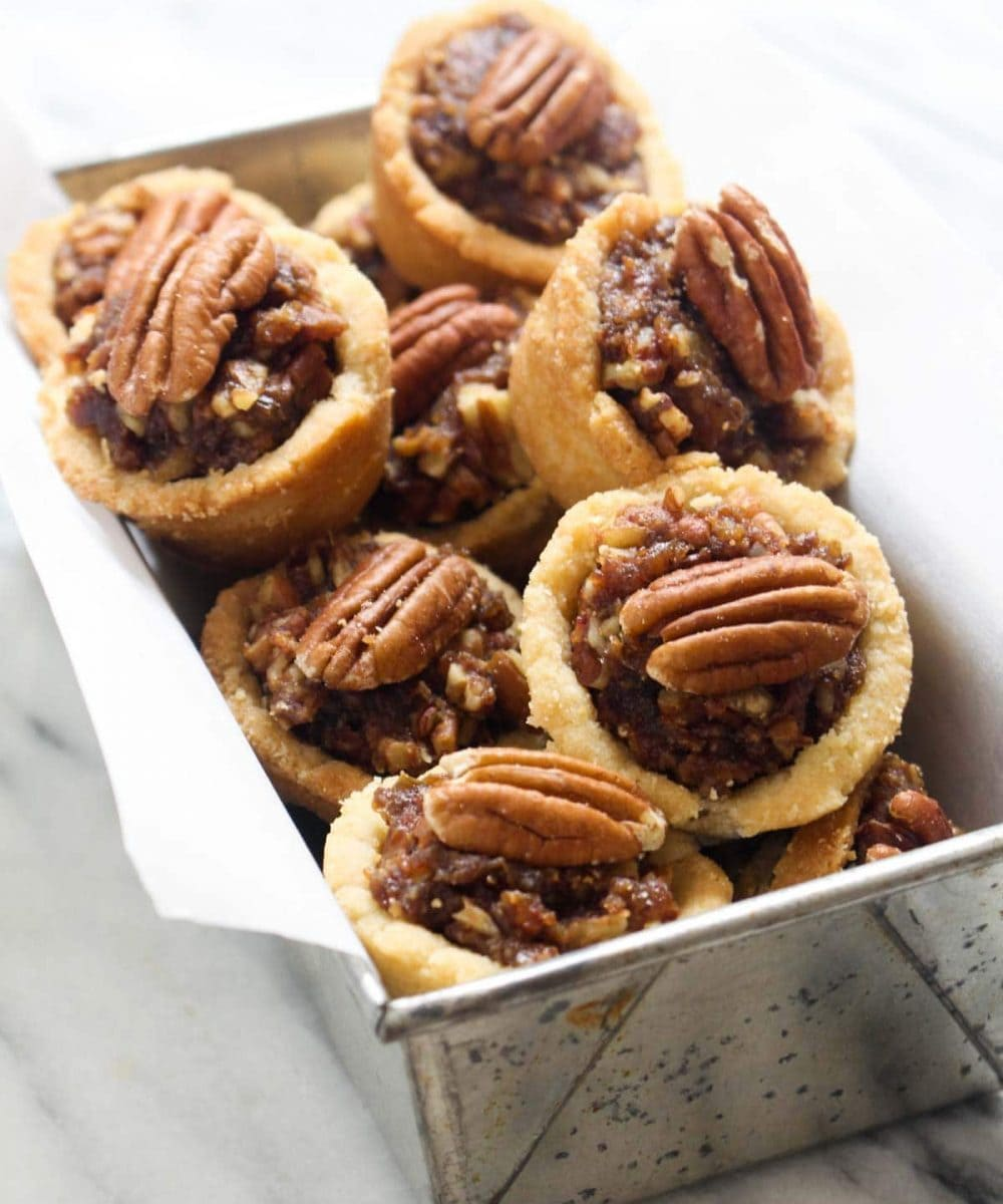 These Mini Pecan Pie Cookies taste just like the real-deal pecan pie in mini cookie form recipe! Only these guys are allergy friendly and made without refined sugar. You get a cookie, you get a cookie, EVERYBODY gets a cookie!