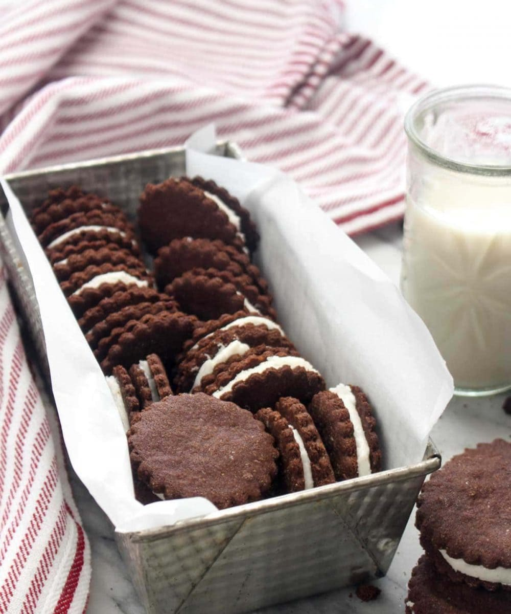 These Homemade Peppermint Oreo Cookies are a gluten free and vegan recipe that will knock everyone's socks off! A perfect Christmas dessert with crisp chocolate wafer cookies, and dense soft peppermint infused filling. Perfect for dunking in milk. | CatchingSeeds.com