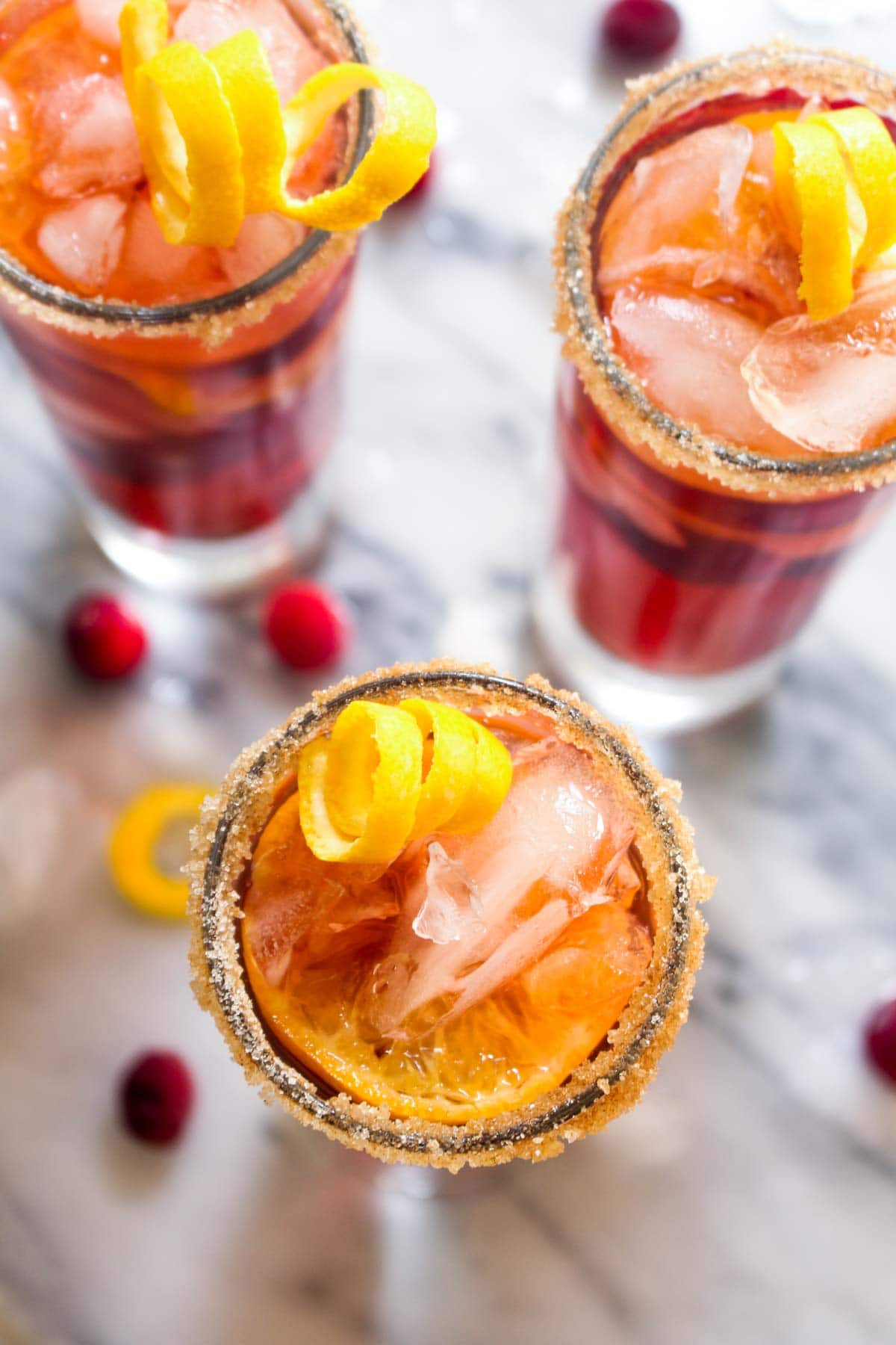 This Kombucha Sangria recipe is a non-alcoholic party drink. Effervescent kombucha gives it a sophisticated feel and cranberries and orange slices infuse this healthy drink with holiday flavor.
