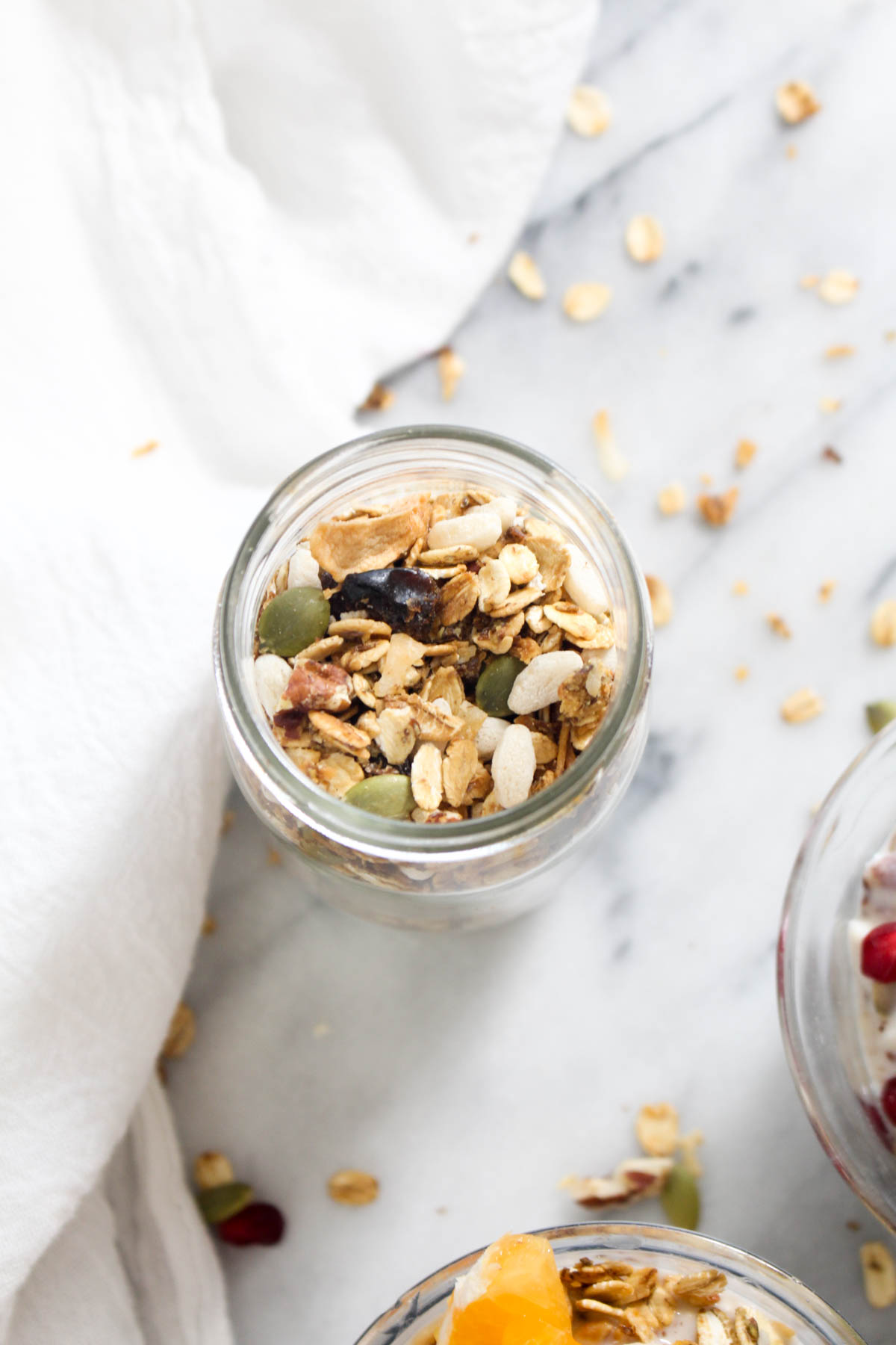 This Winter Fruit Muesli recipe is an easy to make breakfast that is packed with whole grains, healthy fats, and fruit to get you through the morning! This make ahead breakfast recipe is vegan and gluten free. | CatchingSeeds.com