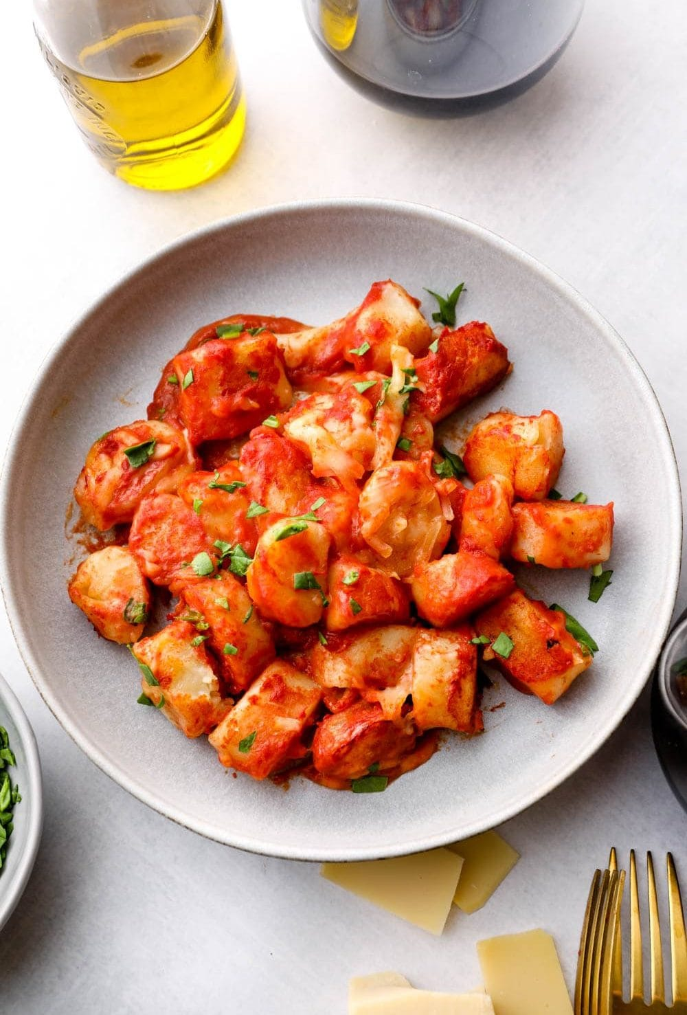 Gluten Free Gnocchi served with tomato sauce and vegan cheese.