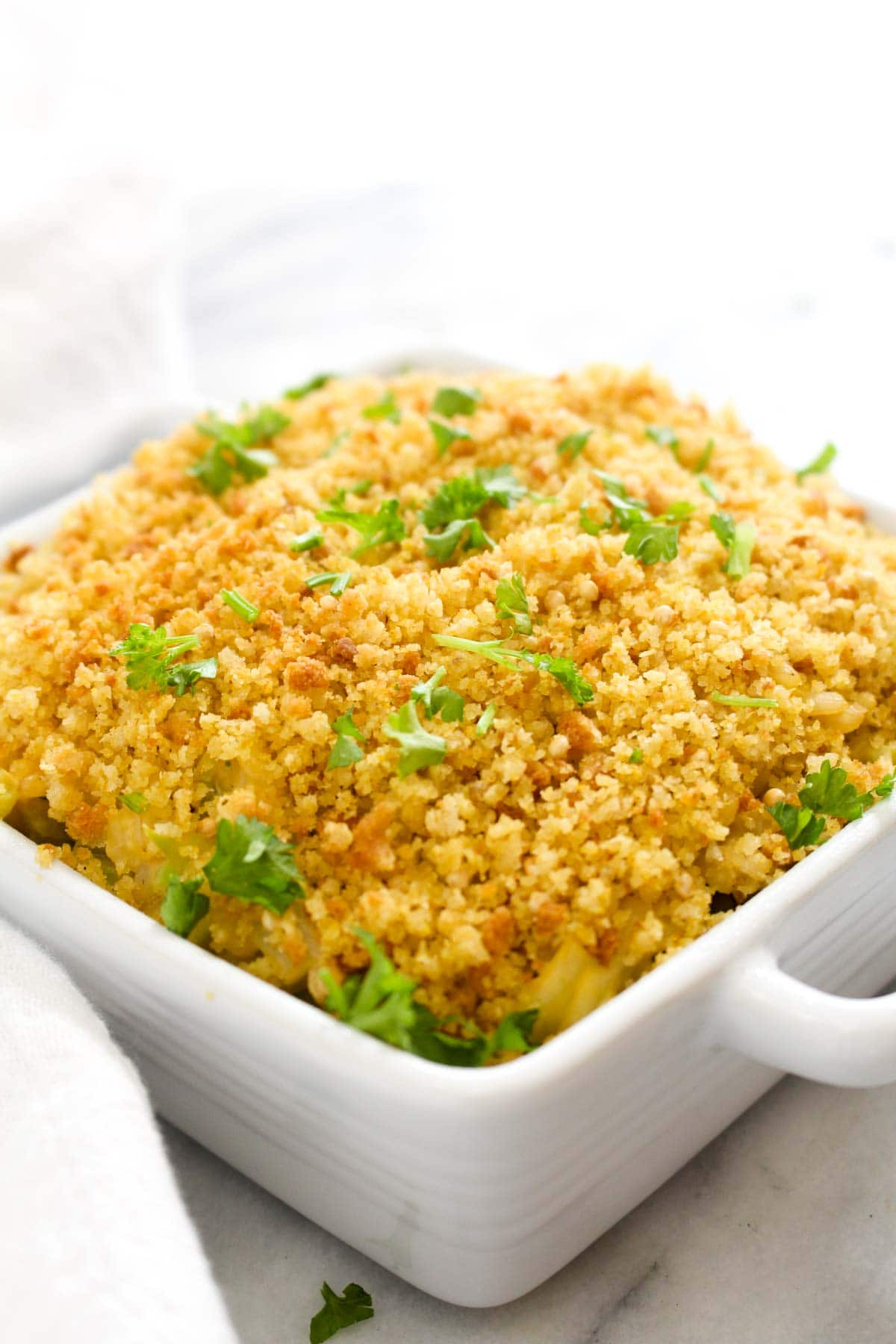 This Cheesy Broccoli Rice Casserole is a hearty and creamy dish that satisfies that itch for comfort food while being completely healthy, gluten-free, and vegan! This quick dish only takes 30 minutes to make, including the time it takes to whip up the cheese sauce. | CatchingSeeds.com