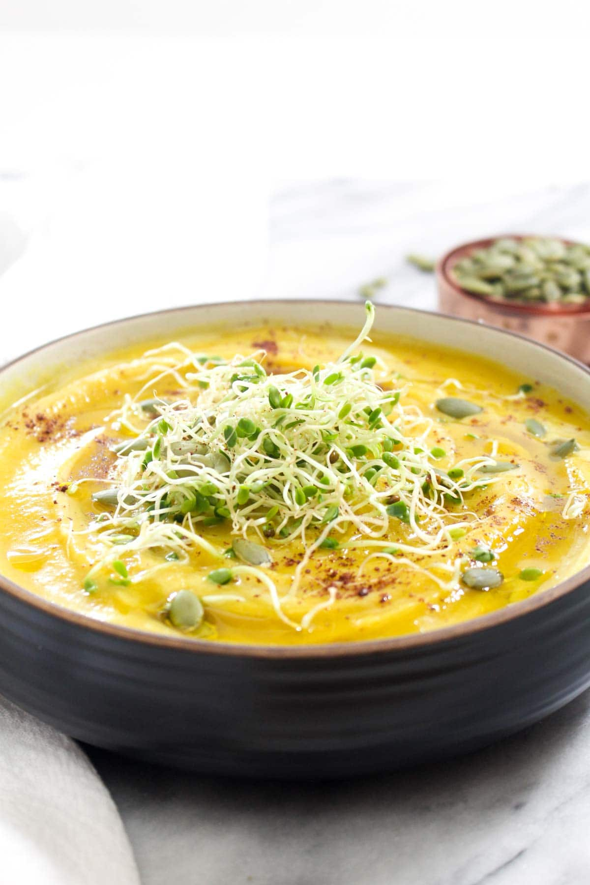 This Golden Beet and Cauliflower Soup recipe is a fast and easy 3 step dinner that is full of flavor and veggies! Ready to eat in just 35 minutes.   CatchingSeeds.com