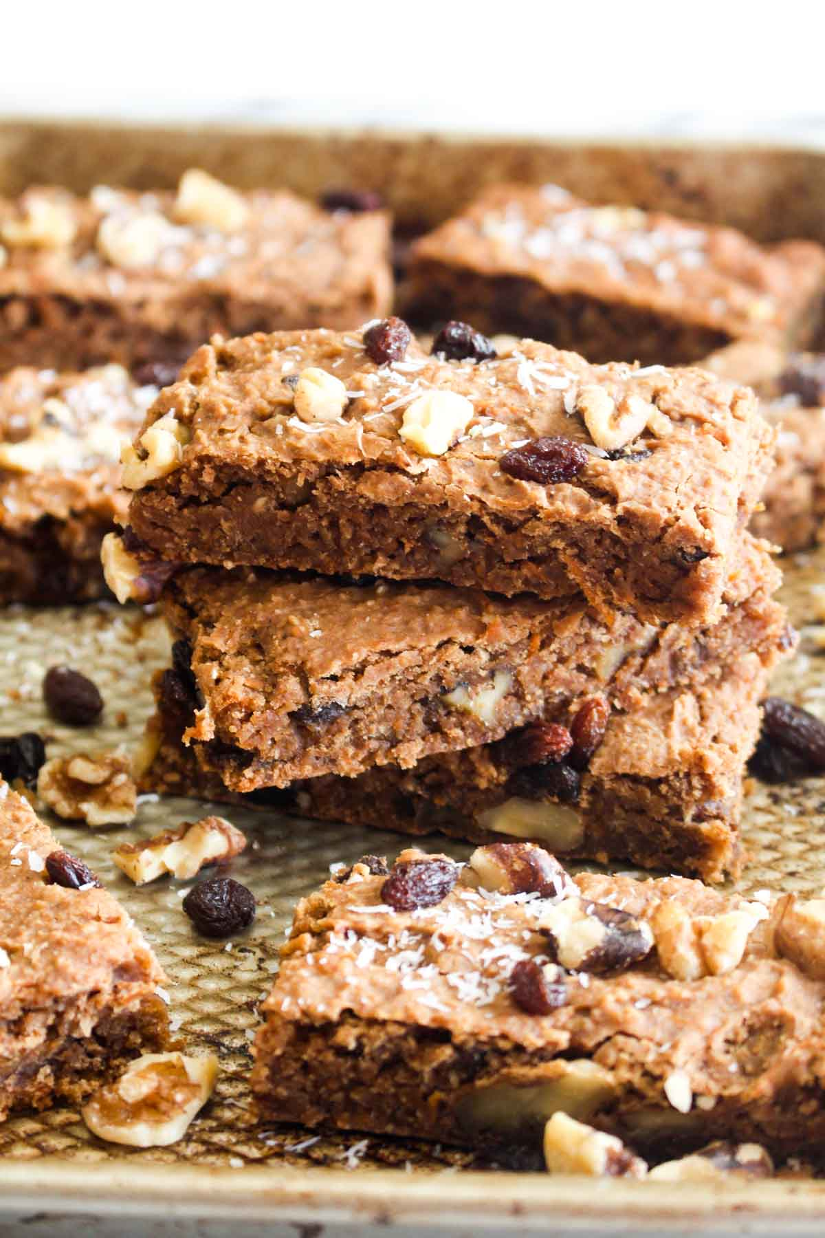 These Carrot Cake Bars are a secretly healthy treat! Full of carrot cake flavors, but made without refined sugar, flour, or oil! | CatchingSeeds.com