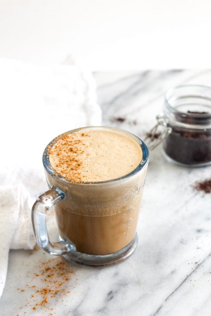 This Vegan Oil Free Bulletproof Coffee recipe will give you loads of energy to start your day! It is made a secret whole foods ingredient that gives you healthy fats without empty calories   CatchingSeeds.com