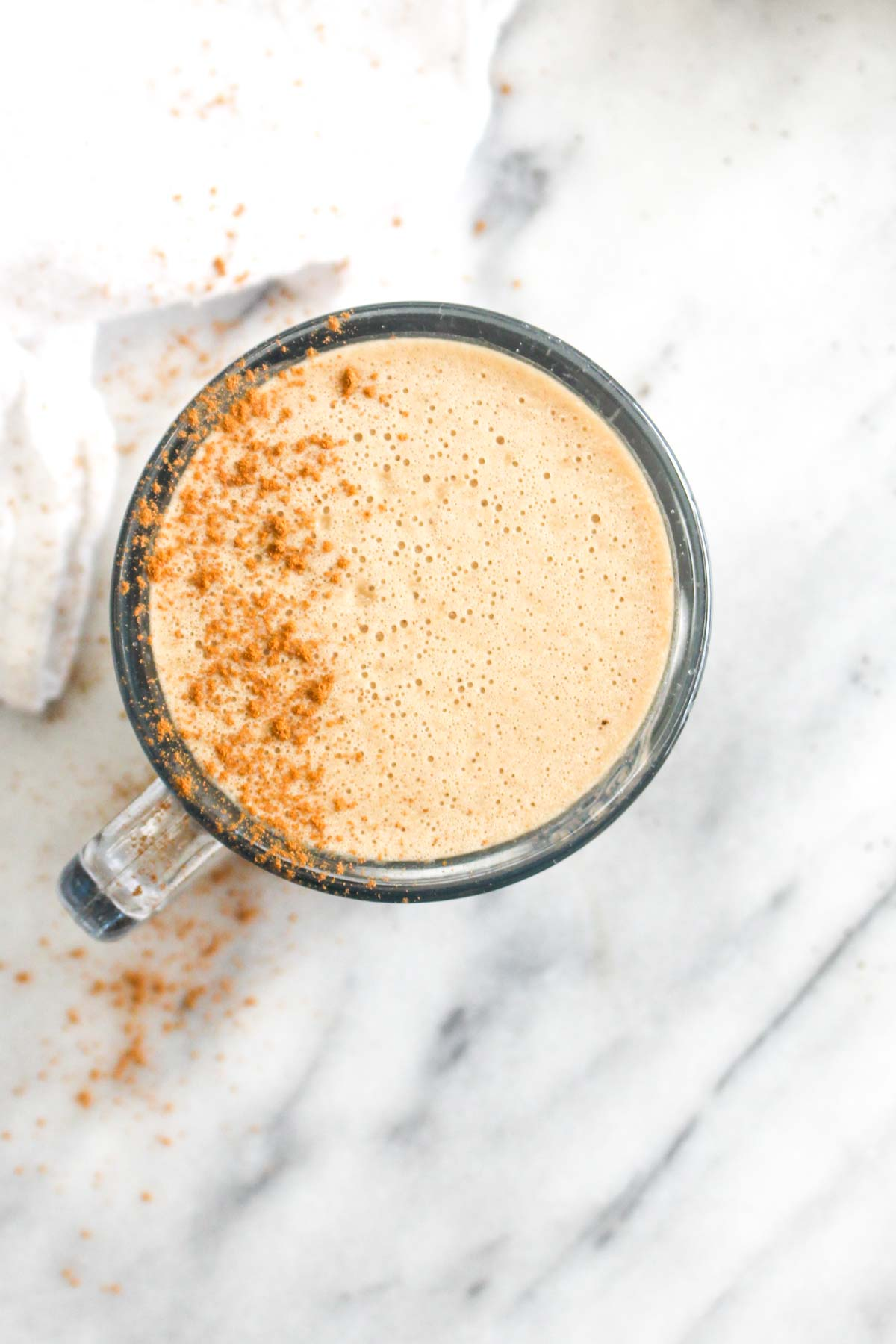 This Vegan Oil Free Bulletproof Coffee recipe will give you loads of energy to start your day! It is made a secret whole foods ingredient that gives you healthy fats without empty calories | CatchingSeeds.com