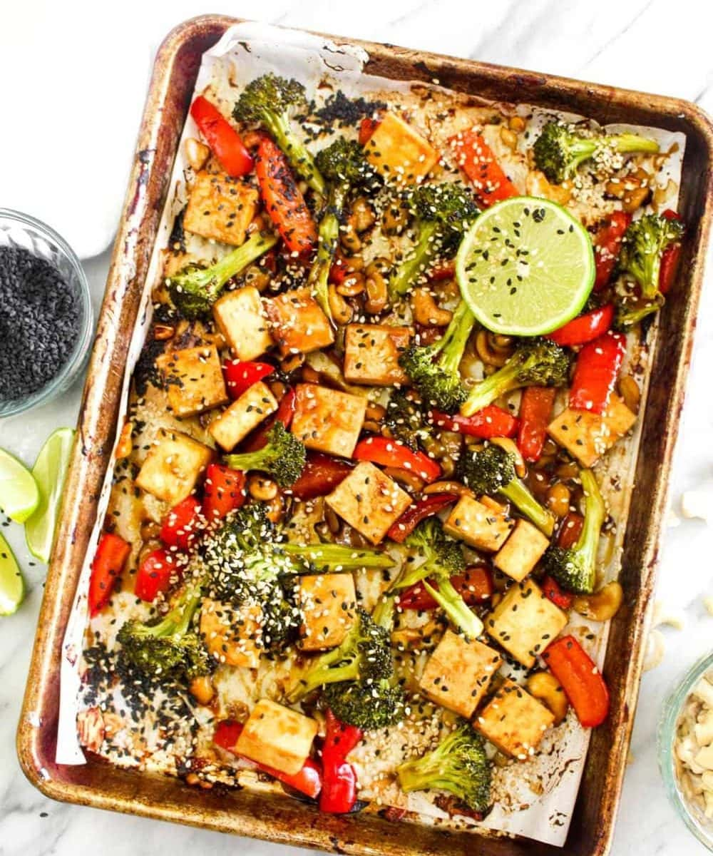 Sheet Pan Chinese Cashew Tofu on a sheet pan with sesame and lime.