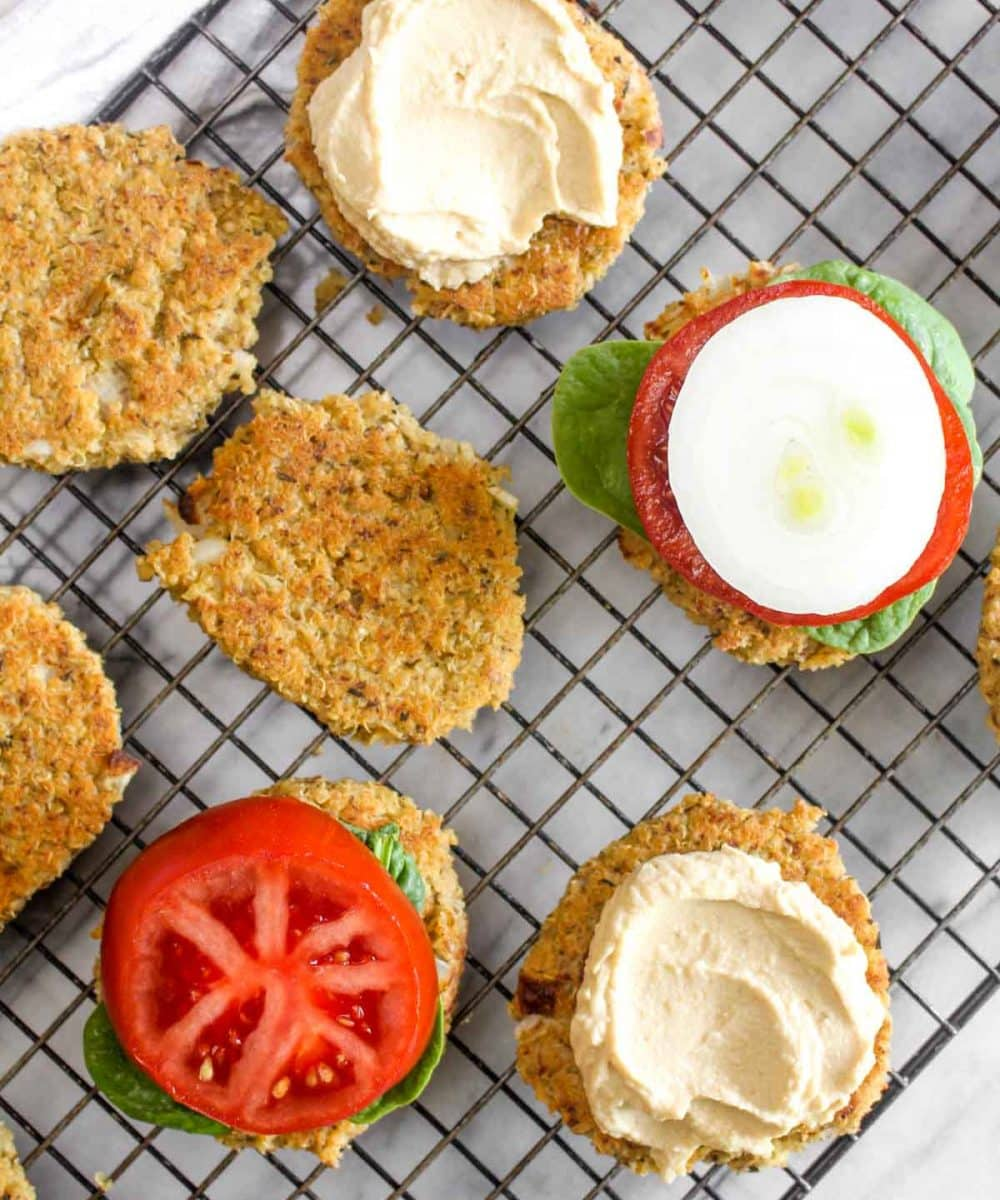 Quinoa patties cooking on baking rack.
