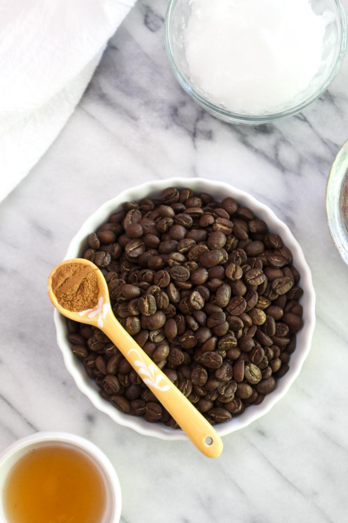 ThisBulletproof Coffee Body Scrub is a deep moisturizer and exfoliant all in one! This scrub can reduce cellulite, reveal radiant soft skin, and reduce the signs of aging with only 4 ingredients! | CatchingSeeds.com