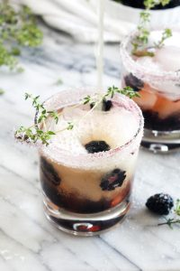 ThisBlackberry Kombucha Vodka Smash is a light and refreshing cocktail recipe for summer nights! This low sugar drink is made healthier with kombucha. | CatchingSeeds.com