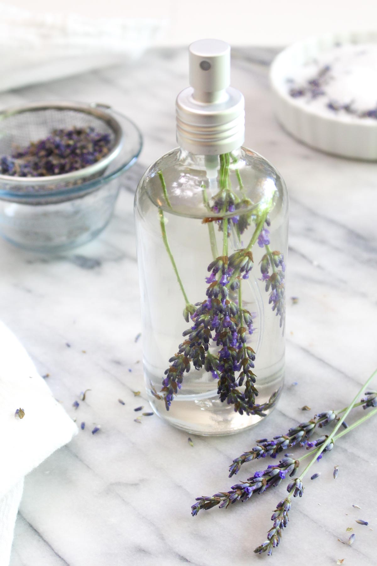 Lavender Linen Spray and Bath Soak are easy DIY recipes that can promote relaxation, reduce stress, and promote restful sleep. | CatchingSeeds.com