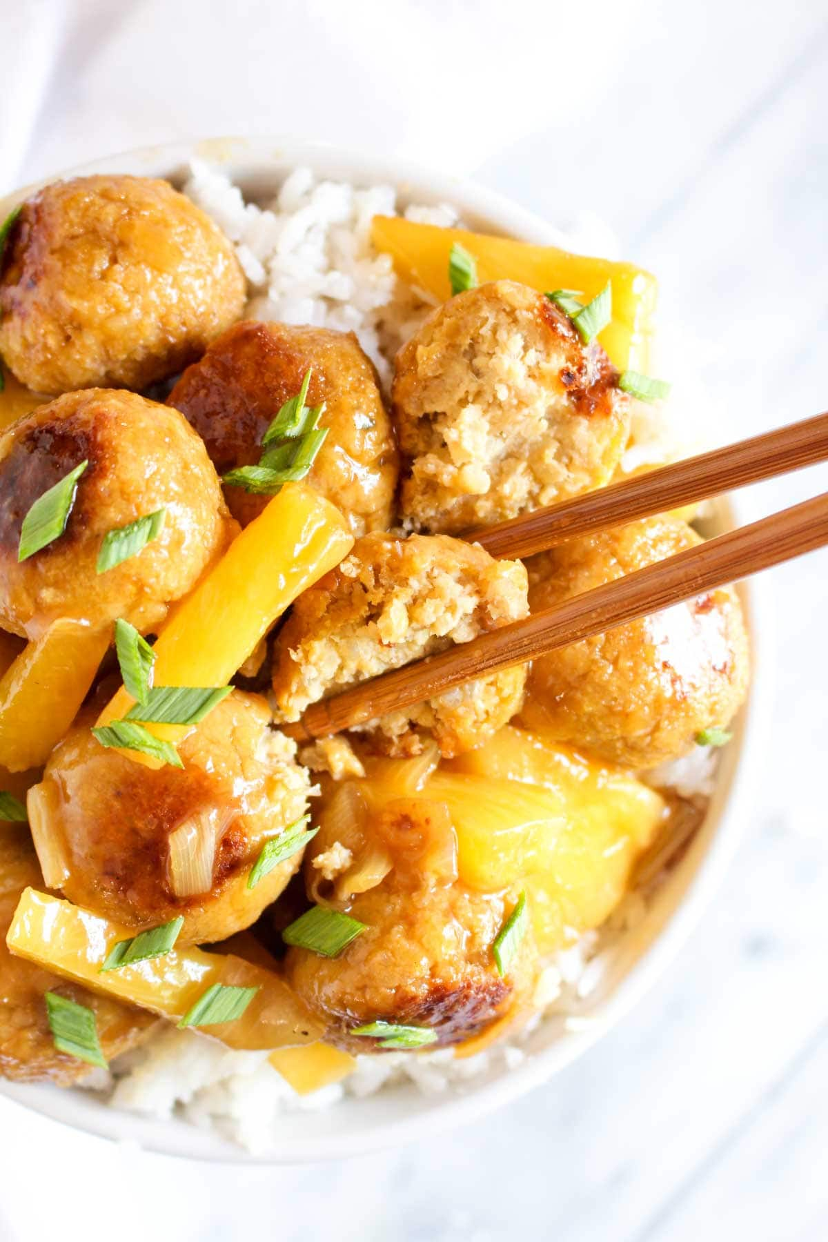 TheseSweet and Sour Tempeh Meatballs are served on a bed offragrant coconut rice and coated in a deliciously sticky sauce. This healthy vegan and gluten free dish is jam packed with flavor. | CatchingSeeds.com