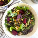 This Roasted Beet Kale Salad recipe is full of interesting flavors and textures. Hearty beets meet herb marinated lentils and crunchy pistachios for a texture and flavor bomb. | CatchingSeeds.com