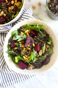 ThisRoasted Beet Kale Salad recipe is full of interesting flavors and textures. Hearty beets meet herb marinated lentils and crunchy pistachios for a texture and flavor bomb. | CatchingSeeds.com