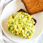 This Vegan Egg Salad Sandwich is an easy 9 ingredient recipe that can be made in 10 minutes! These cool and creamy sandwiches are made healthier with a few simple swaps.| CatchingSeeds.com