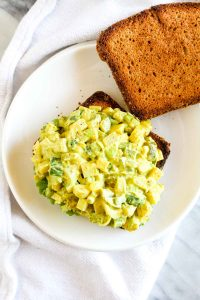 This Vegan Egg Salad Sandwich is an easy 9 ingredient recipe that can be made in 10 minutes! These cool and creamy sandwiches are made healthier with a few simple swaps.  CatchingSeeds.com