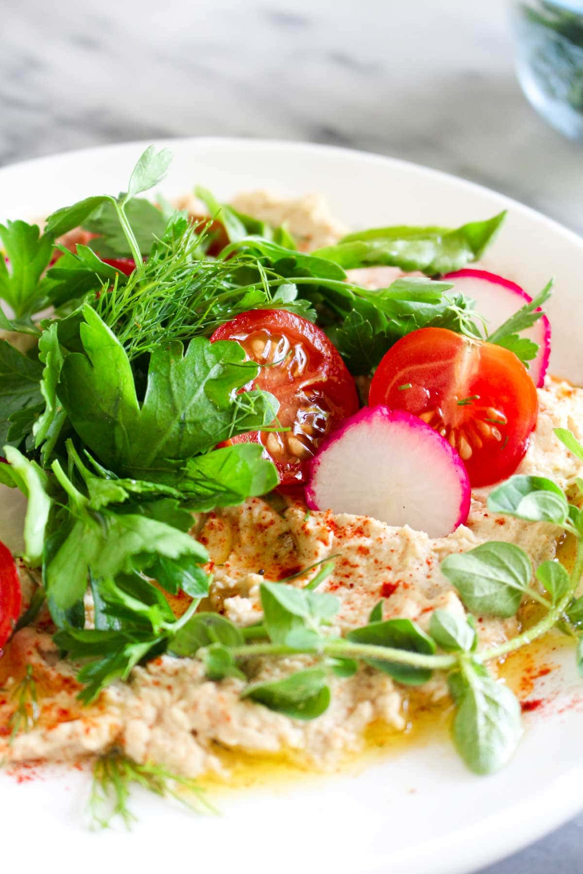 This easy Hummus Salad Recipe ensures you get a bit of creamy hummus in each bite! This healthy side can be made in less than 30 minutes.| CatchingSeeds.com