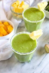 Tropi Kale Smoothie is a 10 minute recipe that is packed with tropical flavors. 6 simple and healthy ingredients make this an easy grab and go breakfast. | CatchingSeeds.com