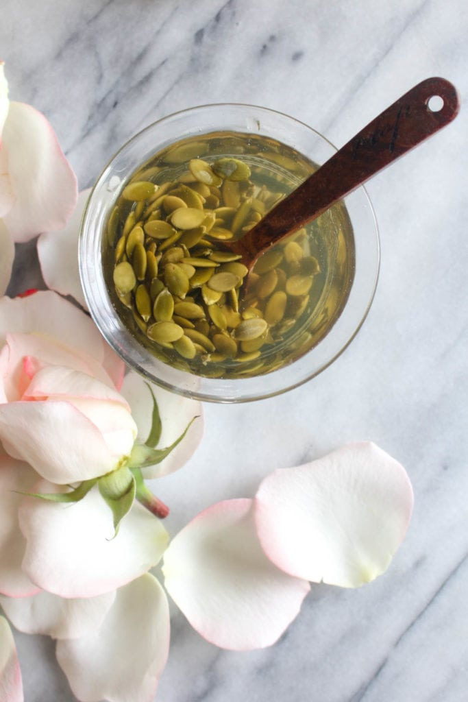 This Pumpkin Seed Rosewater Face Mask is a hydrating and detoxifying facial all-in-one! It will gently clean pores and banish blackheads while hydrating your skin. Great for all skin types - including sensitive. | CatchingSeeds.com