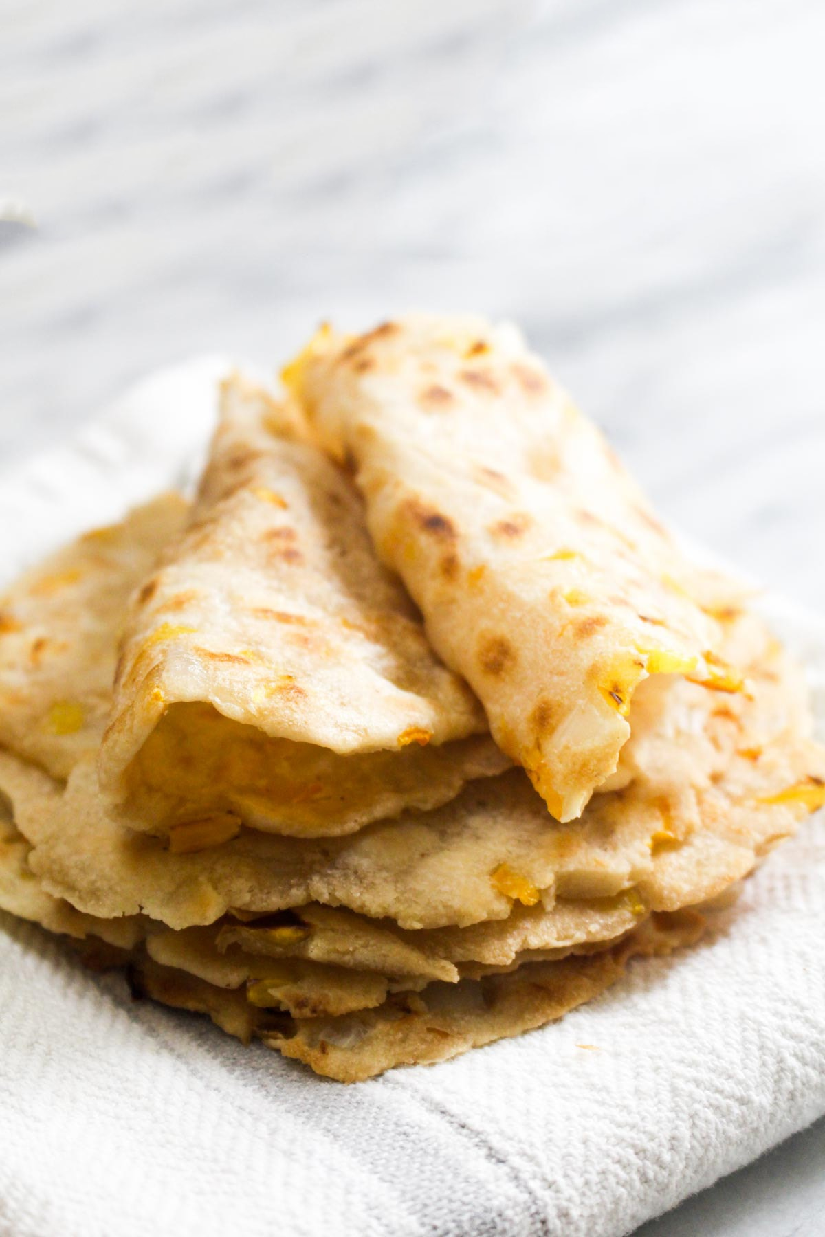 Casava Flatbread is an easy to make grain free and paleo flatbread. It is soft, flexible and full of onions and peppers to give it loads of flavor.   CatchingSeeds.com