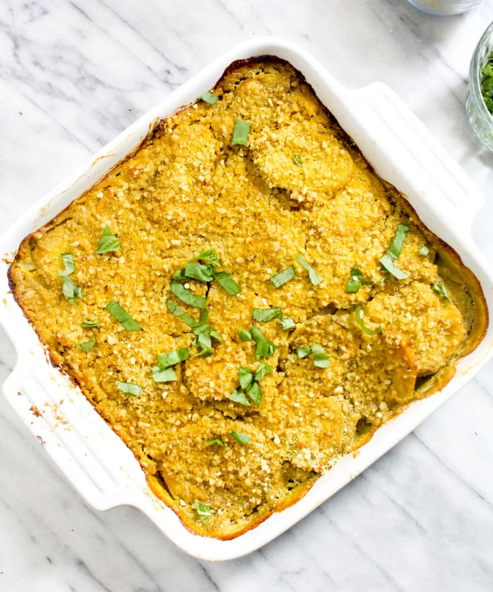 Cheesy Pumpkin Scalloped Potatoes are a rich and creamy Fall side that is secretly healthy! Made without dairy, this recipe has a crispy golden brown parmesan crust. | CatchingSeeds.com