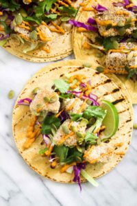 These Crispy Pumpkin Tacos will spice up taco Tuesday with their smokey Chipotle Lime Crema. This recipe is vegan, gluten free, and healthy! | CatchingSeeds.com