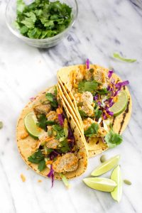 These Crispy Pumpkin Tacos will spice up taco Tuesday with their smokey Chipotle Lime Crema. This recipe is vegan, gluten free, and healthy!   CatchingSeeds.com