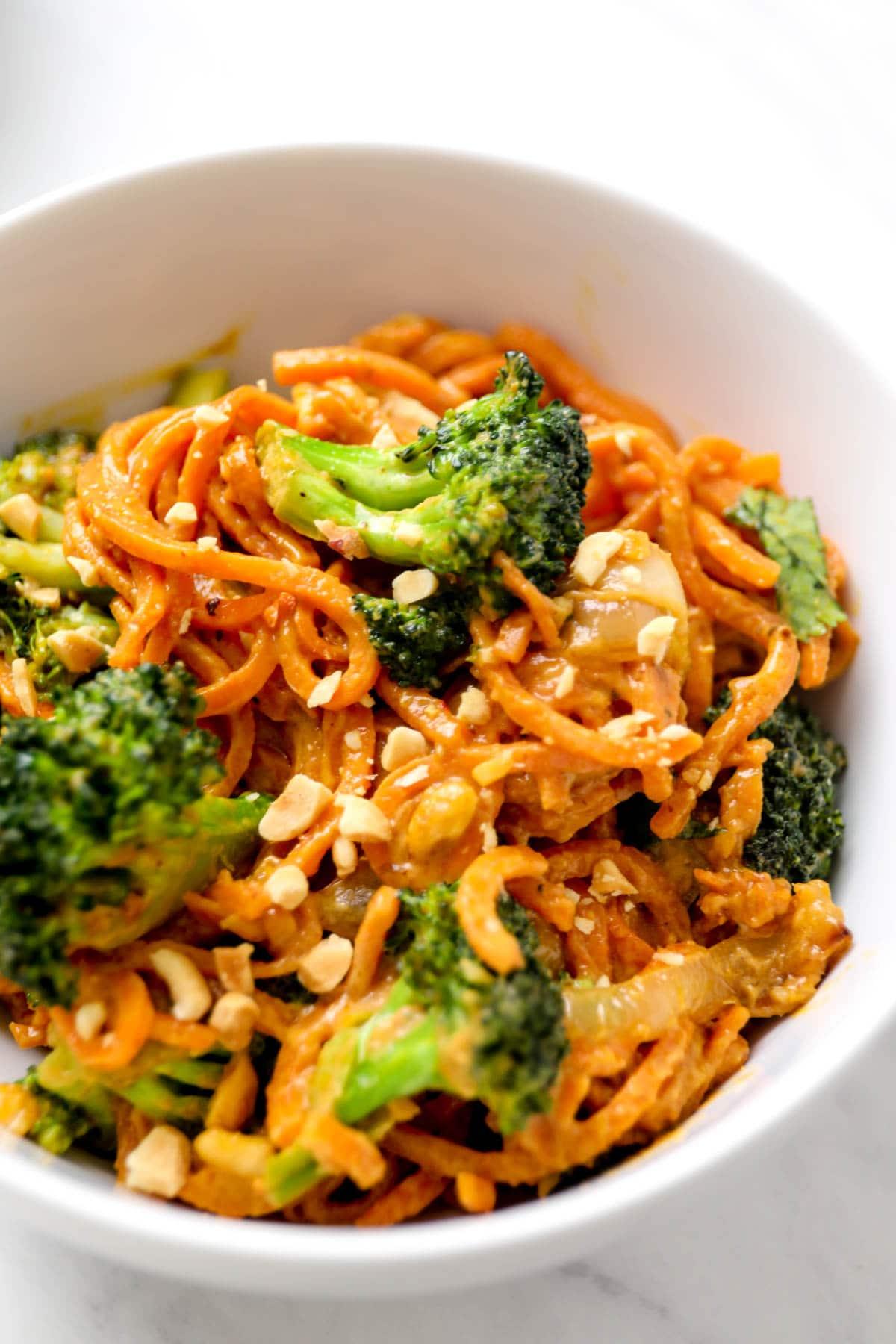 Peanut Sauce Sweet Potato Noodles with broccoli and chopped peanuts.