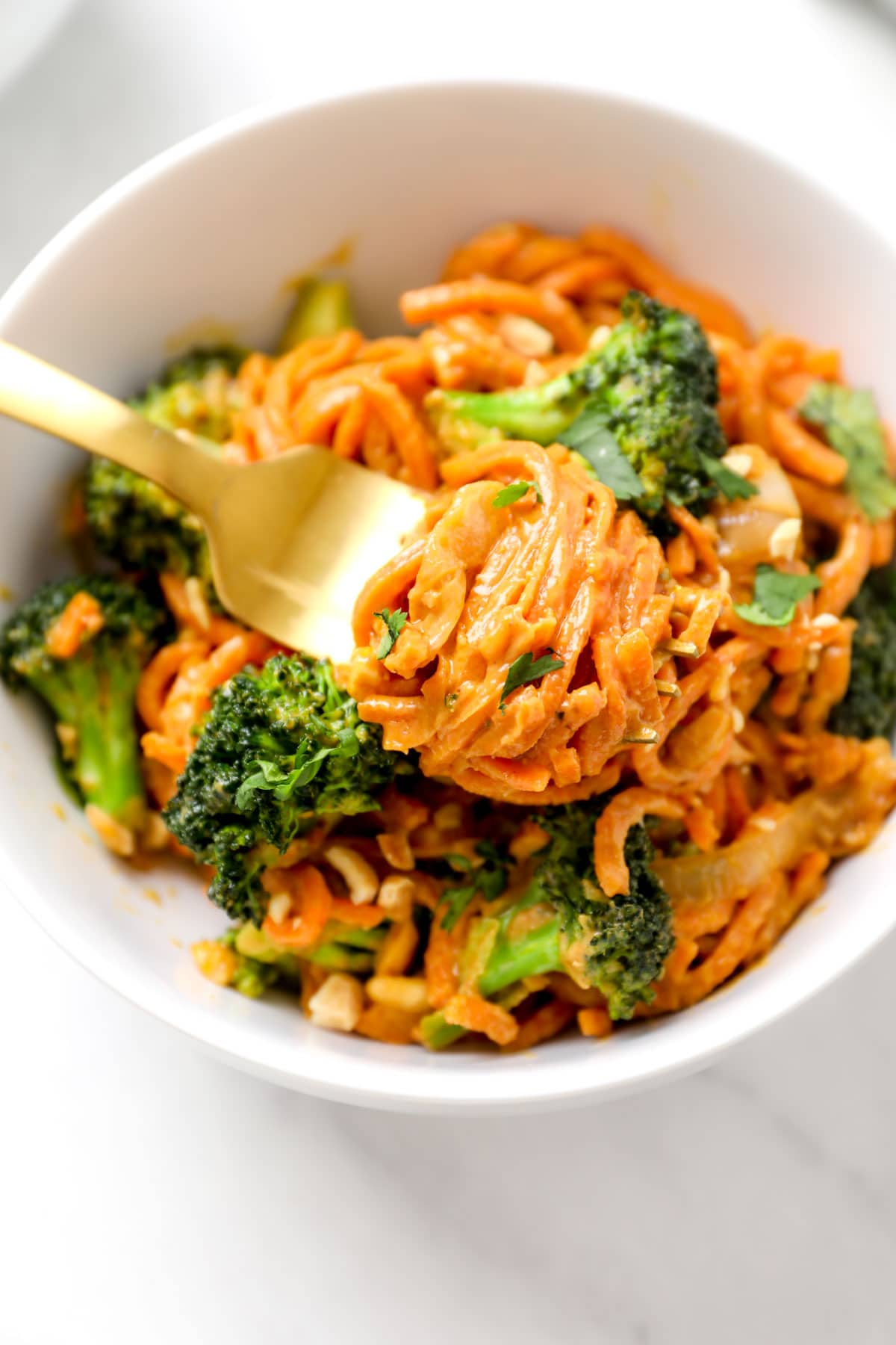 A fork twirled with Peanut Sauce Sweet Potato Noodles.