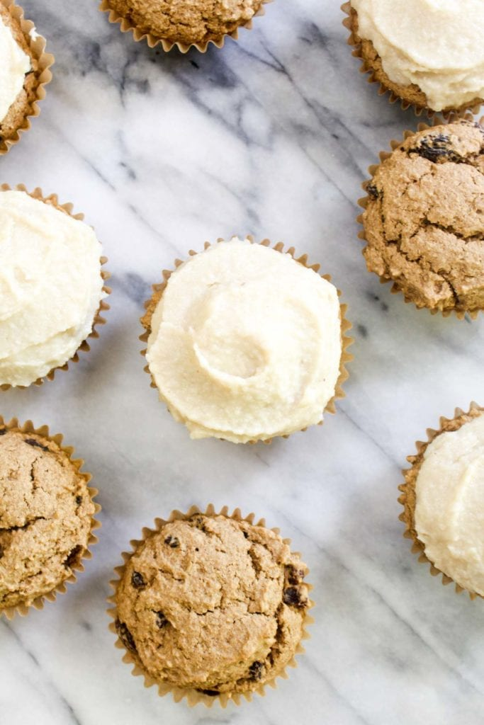 Cinnamon Raisin Cupcakes with Cashew Cream Cheese Frosting is a recipe that tastes like a cinnamon roll in muffin form. These might taste like cupcakes, but they are healthy enough to eat for breakfast! | CatchingSeeds.com