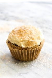 Cinnamon Raisin Cupcakes with Cashew Cream Cheese Frosting is a recipe that tastes like a cinnamon roll in muffin form. These might taste like cupcakes, but they are healthy enough to eatfor breakfast! | CatchingSeeds.com