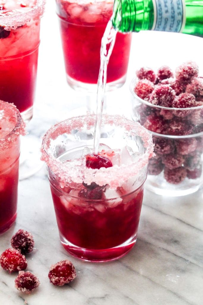 Cranberry Orange Gin Fizz is a festive cocktail filled with Holiday flavor! This easy drink recipe uses anaturally sweetened homemade cranberry sauce for a big punch of flavor. | CatchingSeeds.com
